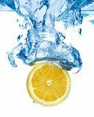 Lemon dropped in a water