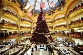 PARIS - DECEMBER 30: The Christmas tree at Galeries Lafayette, trade pavilions with perfume, Decembe