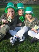 stock photo of saint patricks day  - three siblings pose for a saint patricks day celebration picture - JPG