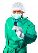 Surgeon holding a stethoscope and looking at camera