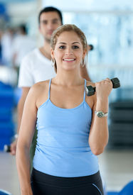picture of workout-women  - beautiful woman at the gym exercising with free weights - JPG