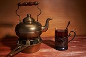 Still Life With A Brass Teapot, Which Is Located On A Stand For Coal, Glass Cup With Tea, A Teaspoon poster