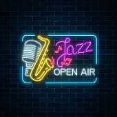 Neon Jazz Festival Banner With Retro Microphone, Saxophone And Lettering In Rectangle Frame On Dark  poster