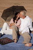 Couple Umbrella Checkers Kiss