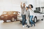 African American Family At Car Dealership. Mother, Father And Son Are Taking Selfie In Front Of New  poster