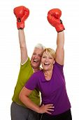 Happy Women Cheering With Red Boxing Gloves