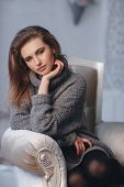 Beautiful Sexy Girl In An Elegant Gray Sweater. Close-up, Portrait Of A Beautiful Woman, Model, Indo poster