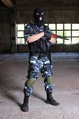 Armed Soldier In Black Mask Hodling A Gun