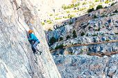 The Girl Climbs The Rock. The Climber Trains On A Natural Relief. Extreme Sport. Active Recreation I poster