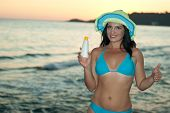 Woman With Suntan Lotion Gives Thumbs
