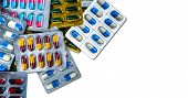 Colorful Of Antibiotic Capsule Pills In Blister Pack Isolated On White Background With Space. Medici poster
