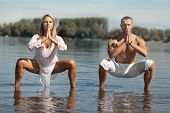 Couple Doing Yoga in Water