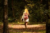 Young Woman With Backpack In A Woods. Hiking At Summertime. Blonde Girl With Pink Backpack Walking A poster