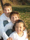 Three Kids On A Slide