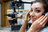 Close up of a young radio host posing in a station