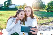 2 Teenage Girls Teenagers, Take Pictures Themselves On Phone, Watch Videos On Social Networks, Appli poster