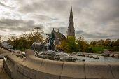 Copenhagen, Denmark: St. Albans Church. Gefion Fountain In Gefjun Turned Her Four Sons Into Oxen poster