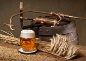 stock photo of spigot  - glass of beer with barley malt and old spigot - JPG