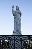 Statue Of Christ In Notre Dame De La Garde In Marseille Against A Bright Blue Sky On A Sunny Day. Ve poster