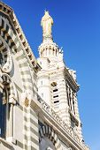 Beautiful View Of Notre Dame De La Garde In Marseille Against A Bright Blue Sky On A Sunny Day. poster