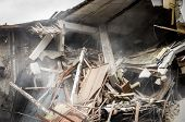 Earthquake Damage, Remains Of Hurricane Or Earthquake Aftermath Disaster Damage On Ruined Old Houses poster