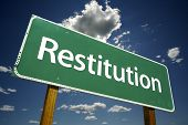 Restitution Road Sign