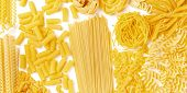 Italian Pasta Texture Panorama, A Flat Lay Banner, Shot From The Top On A White Background. Fusilli, poster