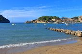 Pictured Is A Cozy Bay Of The Evergreen Island Of Palma De Mallorca. On The Blue Surface Of The Bay  poster