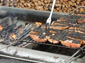 Fresh caught salmon simmering on an outdoor grill