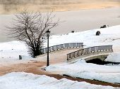 picture of covered bridge  - a bridge in a winter park with a lantern - JPG