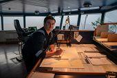 Marine Navigational Officer During Navigational Watch On Bridge poster