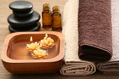 stock photo of essential oil  - essential oils flowers and towels  - JPG