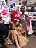 ZAGREB - MAY 26. Two butchers cutting up a woman dressed as cow on Saturday 26th, 2012 in Zagreb, Cr