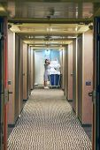 Cleaners Trolley With Cleaning Equipments At Hotel In Hallway . Cleaning Cart With Cleaning Equipmen poster