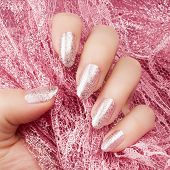Female Hand With Glittered Shiny Rose Nails Is Holding A Glittered Rose Lace, Nail Care And Manicure poster