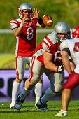 VIENNA, AUSTRIA - JUNE 5 QB Christoph Gross (#8 Austria) during the snap on June 5, 2011 in Vienna,