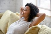 African American Woman Relax On Comfortable Couch At Home poster