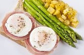 foto of rutabaga  - Two poached eggs on thin slices of Pancetta over toasted wholewheat bread served with roasted asparagus and Rutabaga - JPG