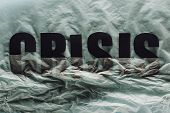 Black Word Crisis Sinking In Paper Symbolizing Water On Grey Paper Background poster