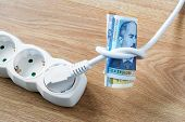 White Electric Cable With Plug Tied To A Knot On A Roll Of Bulgarian Leva Banknotes. Cost Of Electri poster