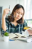 Confused Portraityoung Woman Holding Credit Cards Having Problem Online Payment With Credit Card Ma poster