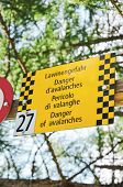 Yellow Tourist Sign Warns Of Avalanches In Four Different Languages. Warning In German, French, Ital poster