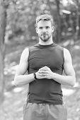 Outdoor Sport Training. Muscular Man In Fitness Bracelet. Digital Sport. Athletic Man In Sportswear. poster