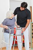 picture of zimmer frame  - Happy senior woman and trainer looking at each other - JPG