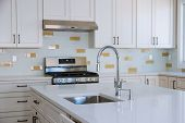 Modern Domestic Kitchen Cabinets With New Appliances And Sink In Kitchen poster
