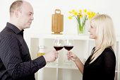 Man And Woman Toasting Each Other