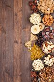 foto of pecan tree  - Frame of variety of fruits and nuts on a dark wooden surface - JPG