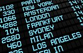 stock photo of sign board  - Departures board at airport terminal showing international destinations flights to some of the world - JPG