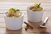 picture of sprinkling  - Creamy rice pudding sprinkled with cinnamon over wood table - JPG