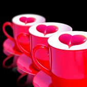 Three Red Mugs With Heart